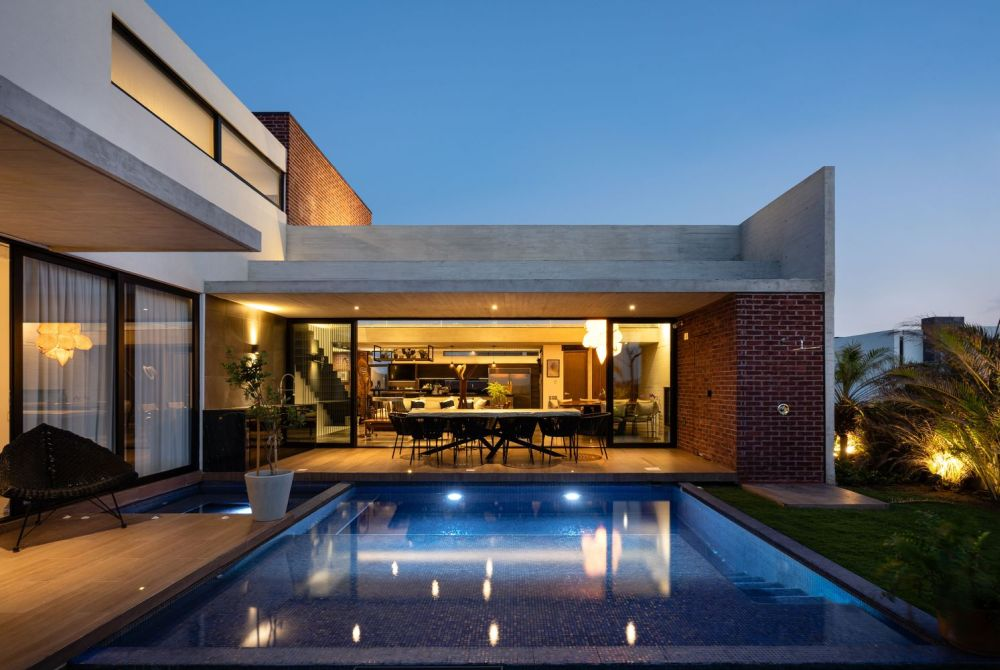 The ground floor opens onto a backyard with a swimming pool and a terrace