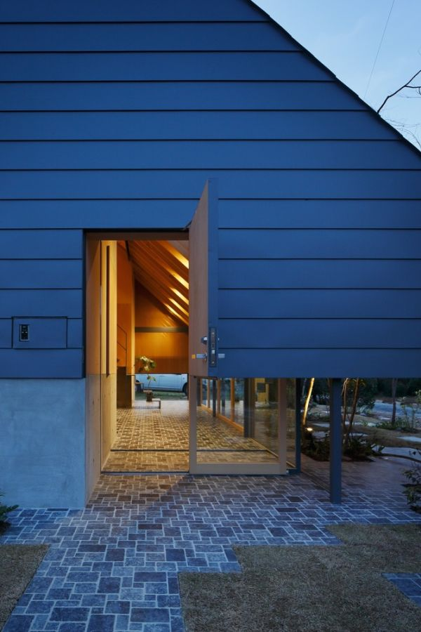 This lower section of the house is framed in glass which give the impression of floating structure