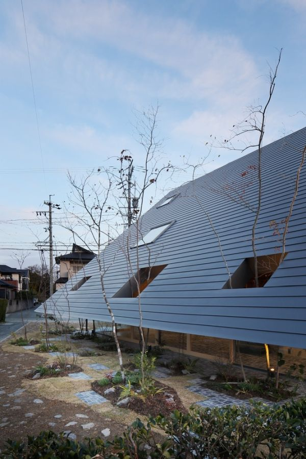The extended eaves create a series of sheltered spaces that help blend the indoor and outdoor