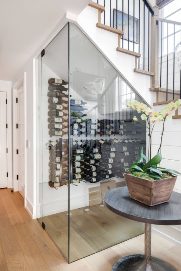 Example of a beach style light wood floor wine cellar design in Los Angeles