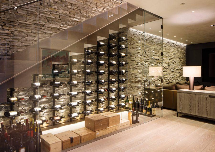 Example of a mid sized trendy light wood floor and beige floor wine cellar design in Denver