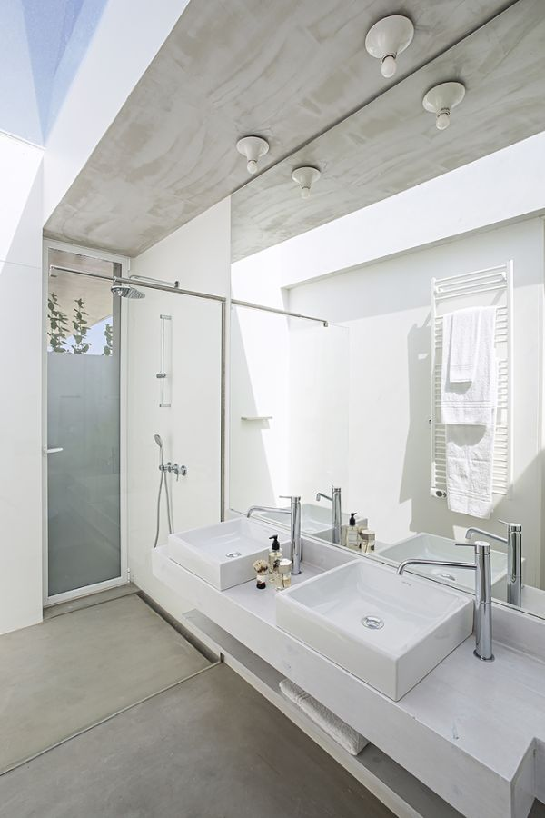 A big skylight fills the bathroom with natural light and gives it a very airy look