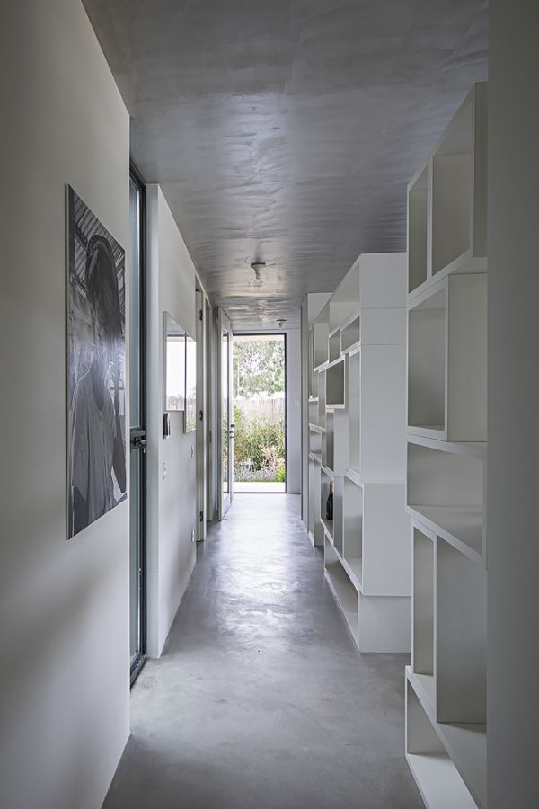The day areas are separated from the bedrooms by a small hallway