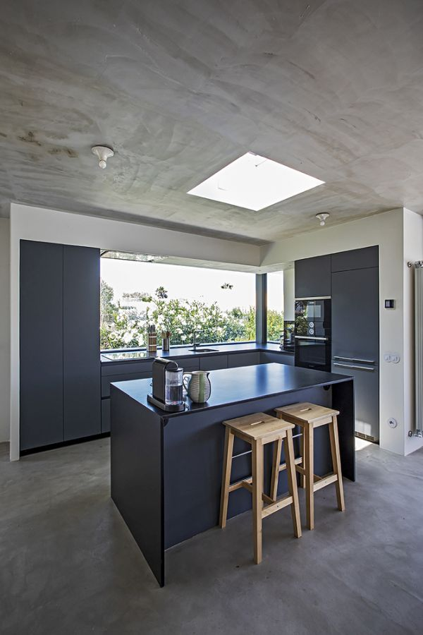 The concrete floors and ceilings add uniformity to the interior areas