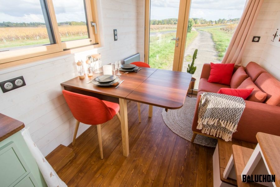 The dining table can be folded down to save space when not needed