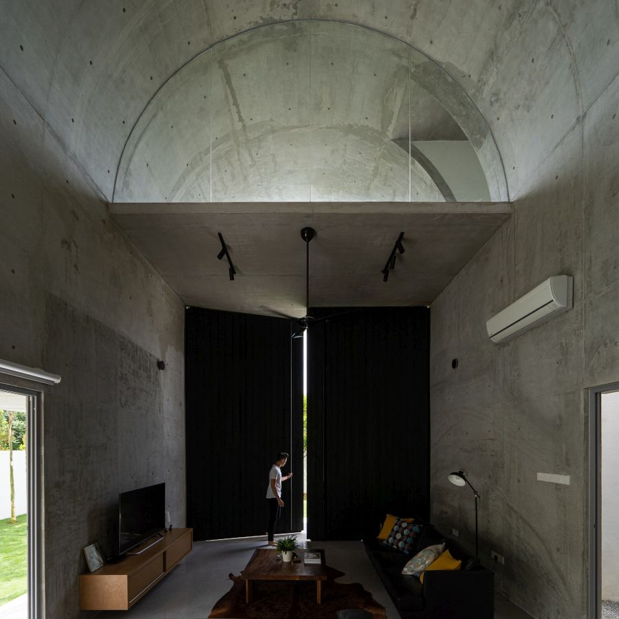 This section of the house features a rugged concrete finish on both the interior and the exterior