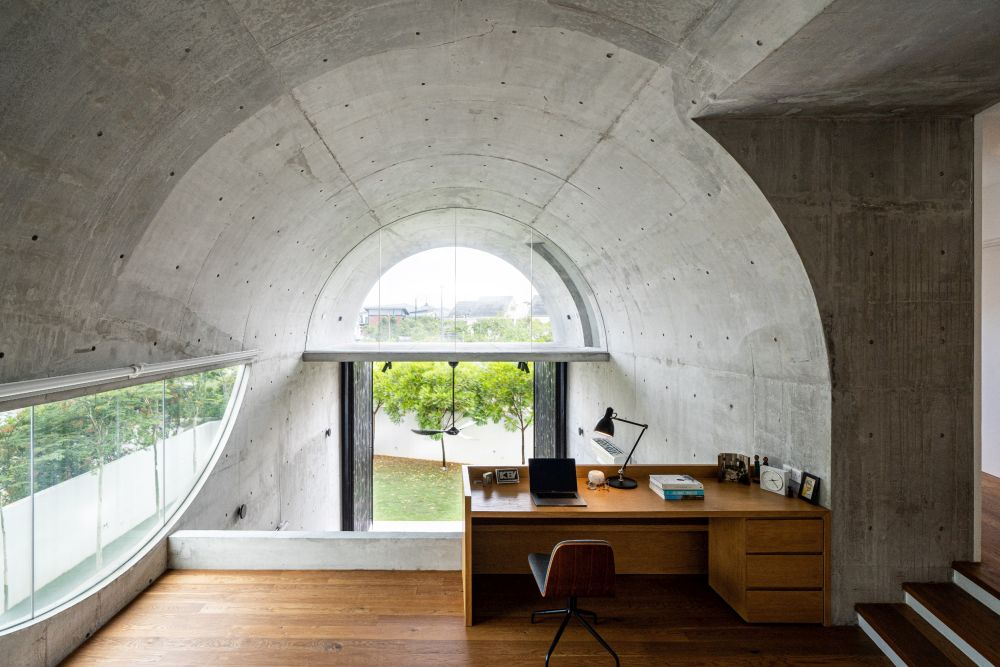 The height of the vaulted ceiling was cleverly utilized to create a series of layered spaces