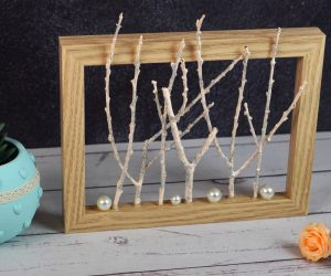 Old Picture Frame Decorated With Glittery Twigs and Pearls