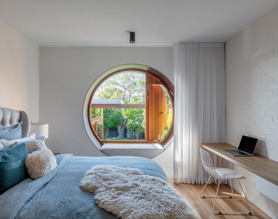 The frame around the big circular window can also be used as a cozy seat