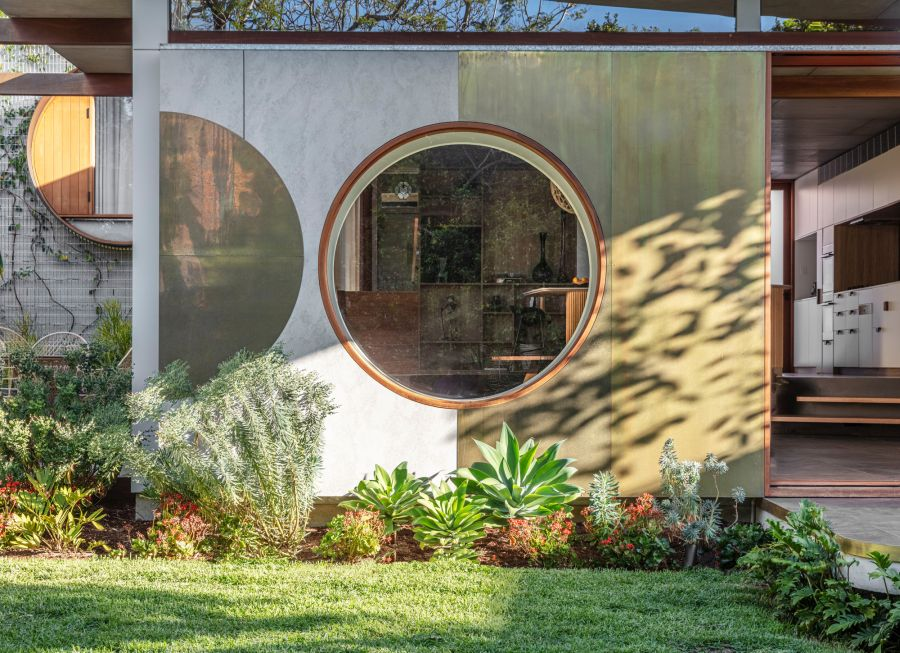 The circular windows have two layers of shutters, both solid and translucent