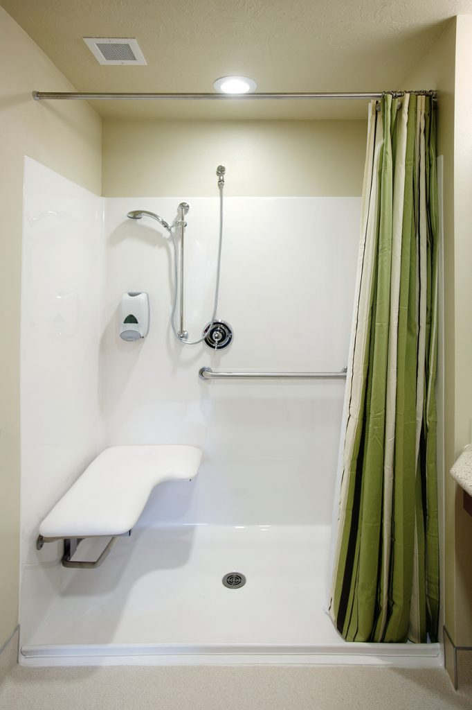 Walk in shower with green curtain