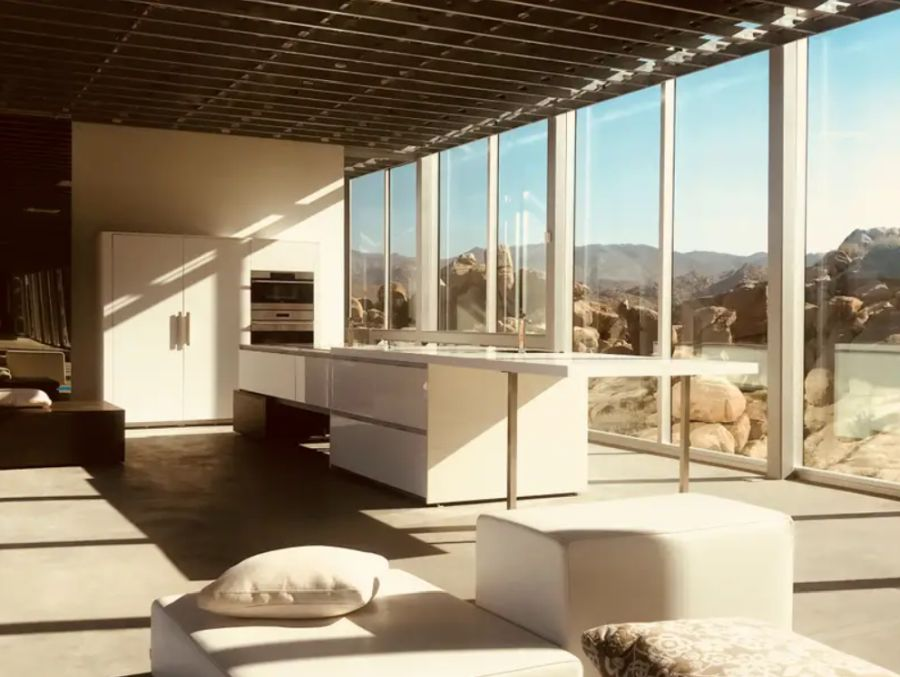 The kitchen has an open design and takes advantage of the abundance of natural light