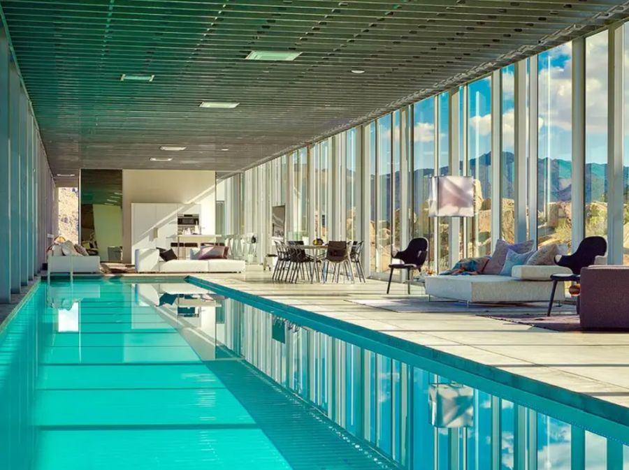 The social areas are arranged around a 30 meter long indoor swimming pool