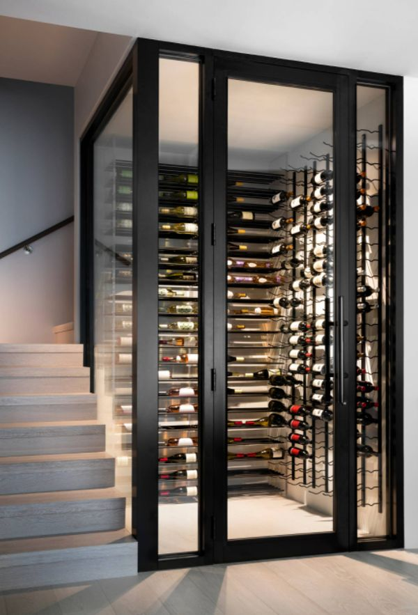 mid sized contemporary light wood floor and brown floor wine cellar idea in Miami