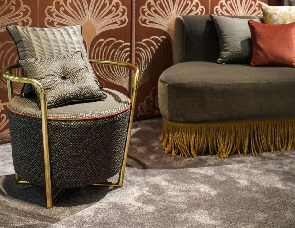 Gray accent chair with gold frame