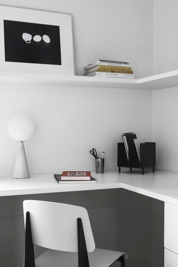 Transitioning into the private areas, the color palette remains simple and minimalistic
