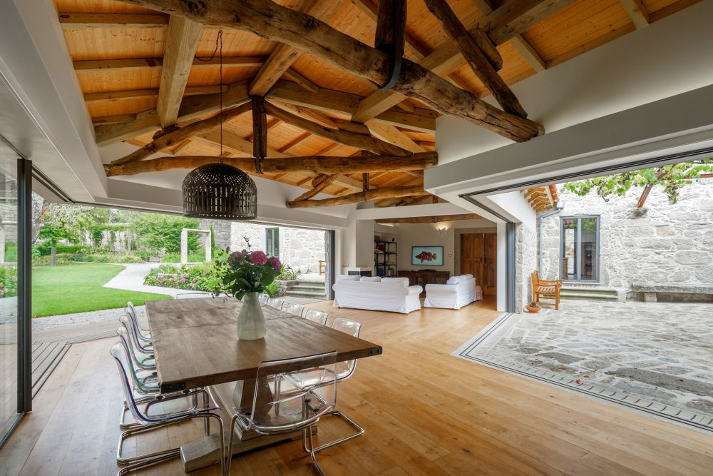 The courtyard seems to push itself into the living area creating a seamless indoor-outdoor connection