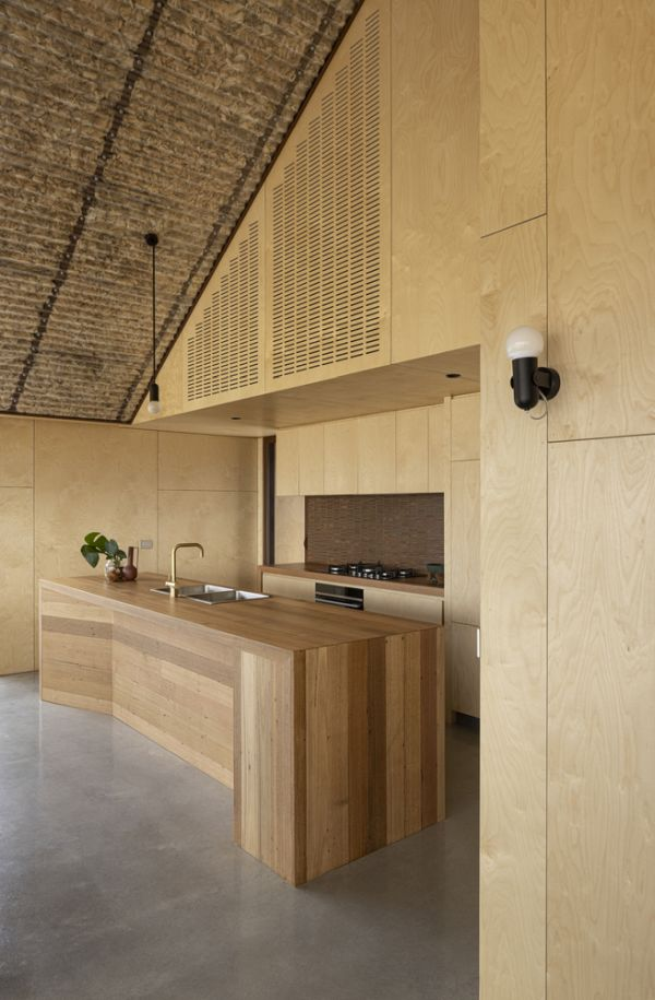 The open kitchen features a geometric island with an elegant design