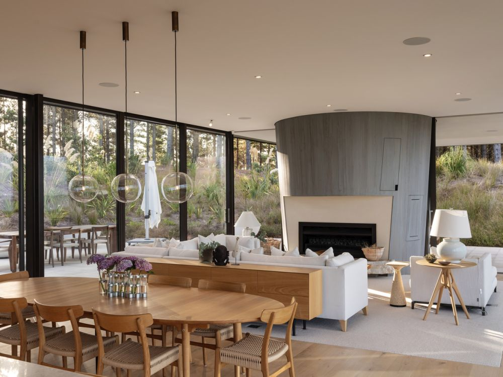 There's actually two fireplaces on opposite sides of the cylinder, one for the indoor and one for the outdoor area