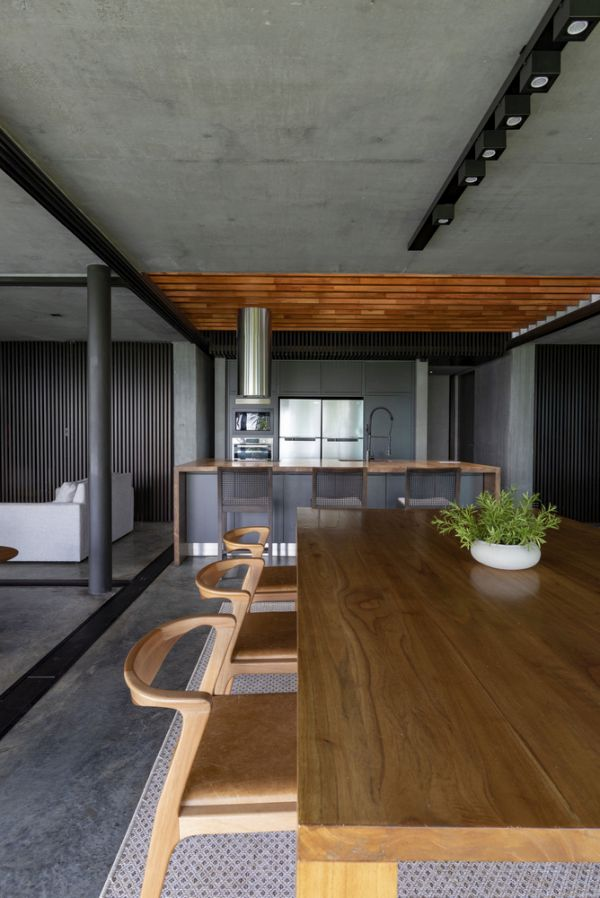 The concrete flooring and the ceiling give the interior a modern-industrial feel