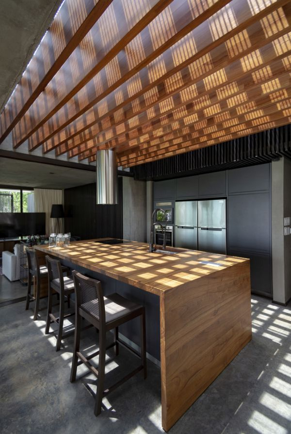 The kitchen has a beautiful open ceiling design that brings sunlight in from above