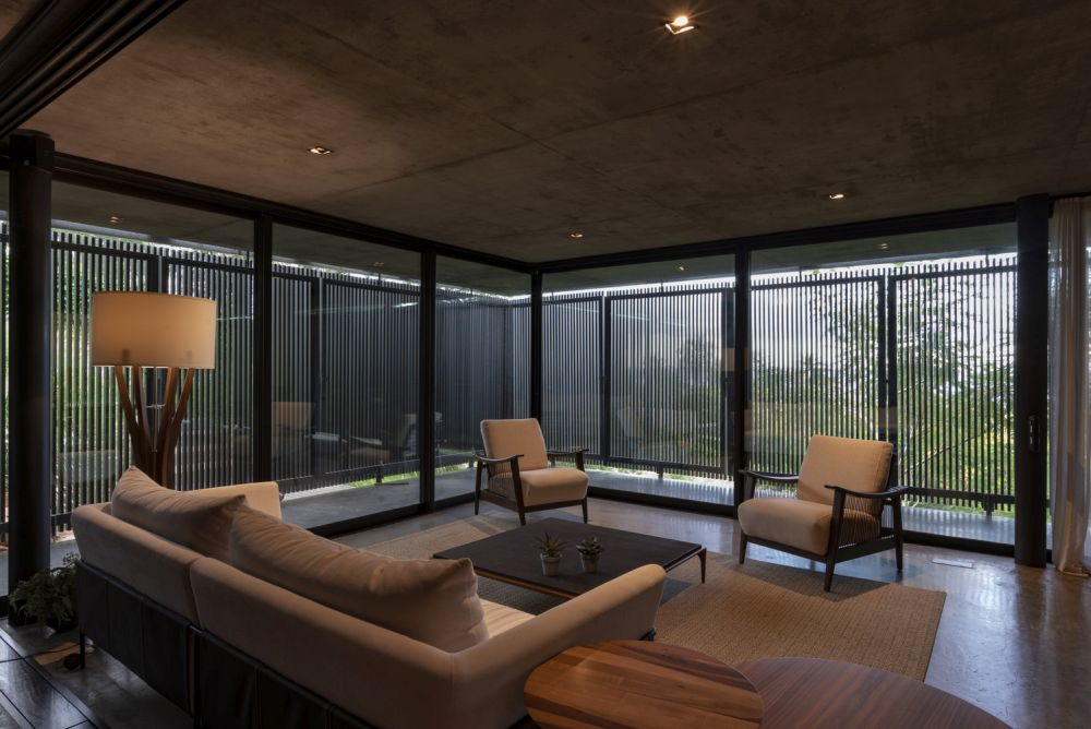 from inside, the folding panels let some of the light and views into the living area