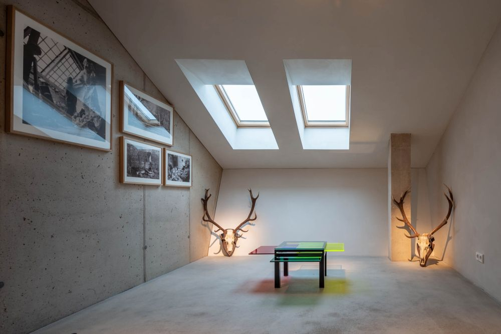 This beautiful gallery space has an angled ceiling with skylights that fill it with natural light