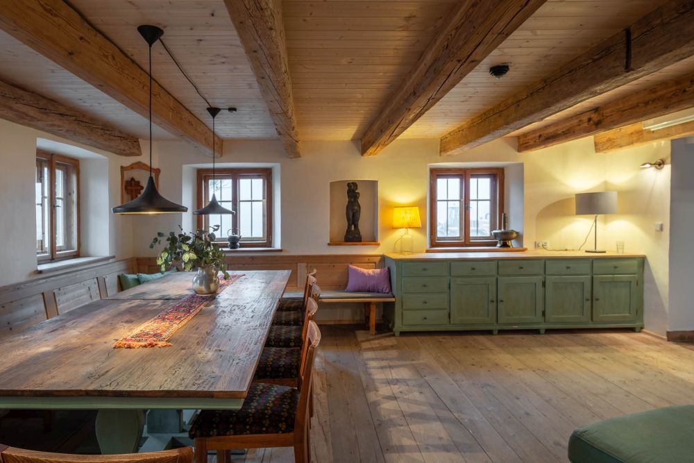 There's also a cozy kitchen and dining area where guests can spend time together