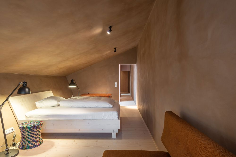 The top floor rooms have this attic-inspired feel because of how low the angled ceiling is