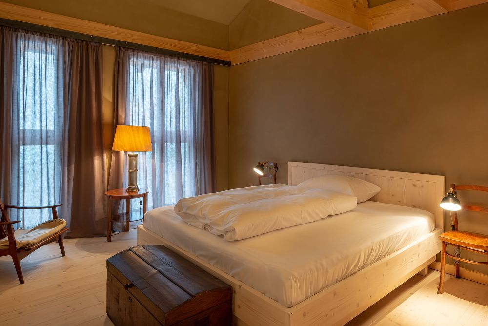 The muted and earthy color palette creates a very warm and cozy ambiance inside the rooms