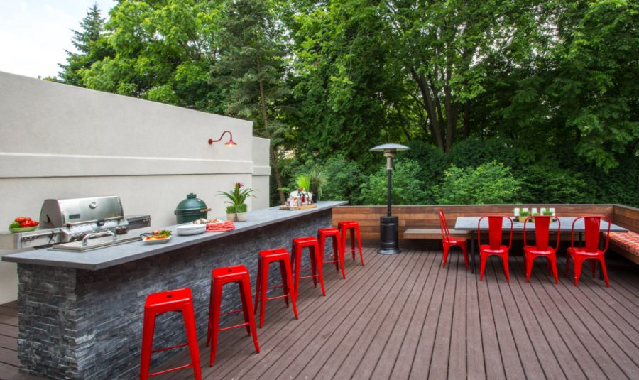 Modern Outdoor Kitchen With Accent Red Chairs