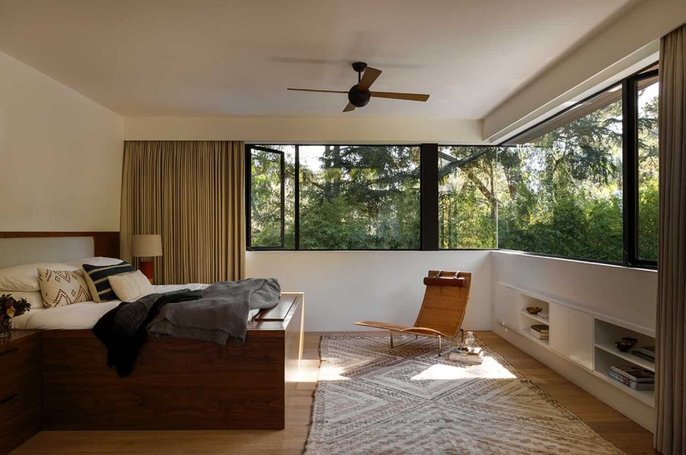 This magnificent bedroom has a gorgeous view thanks to the corner windows