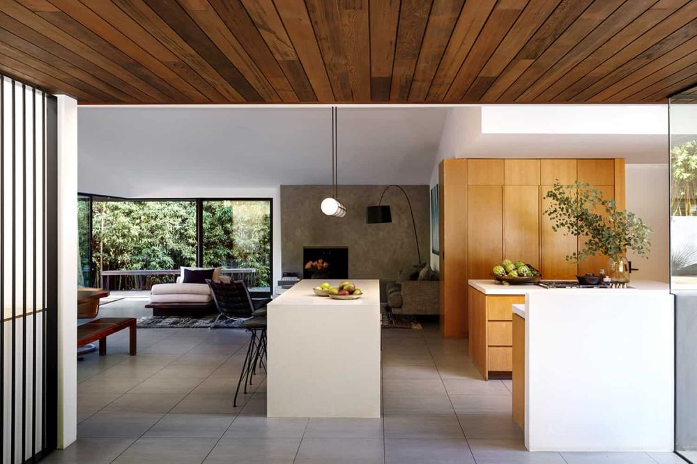 The living room seamlessly extends outdoors onto the pool deck