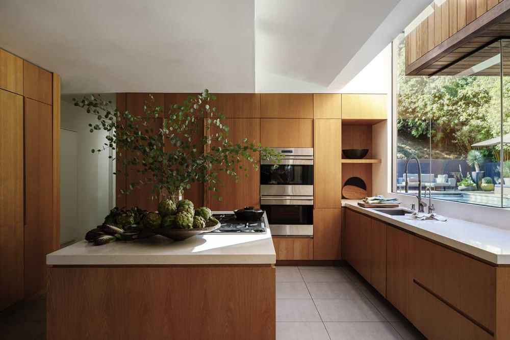 The custom wood furniture adds a lot of warmth and elegance to the kitchen