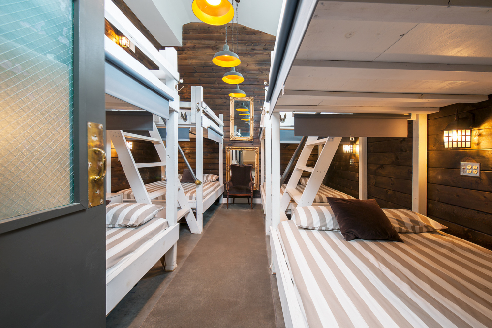 The guest bedroom features multiple bunk beds and can accommodate both big and small groups