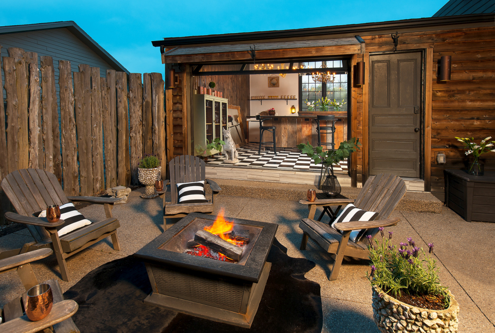 When the glass garage door opens the kitchen has a direct connection to this beautiful fire pit seating area