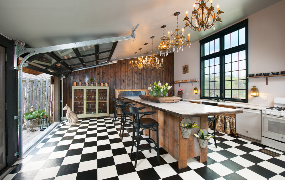 An array of seven vintage chandeliers give the kitchen a glamorous and sophisticated vibe