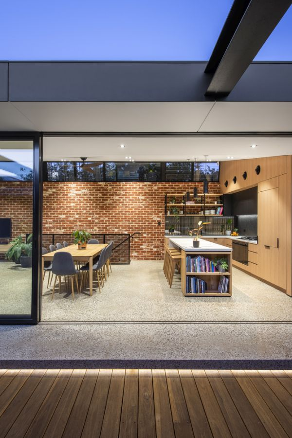 The social areas transition seamlessly outside and onto a lower deck area