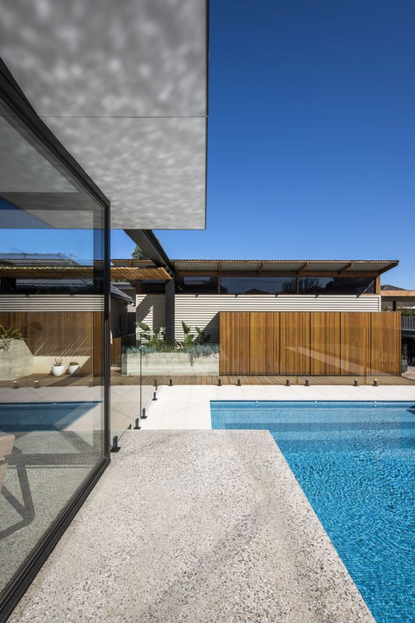The glazed walls and the extended concrete floor make the indoor and outdoor areas feel close