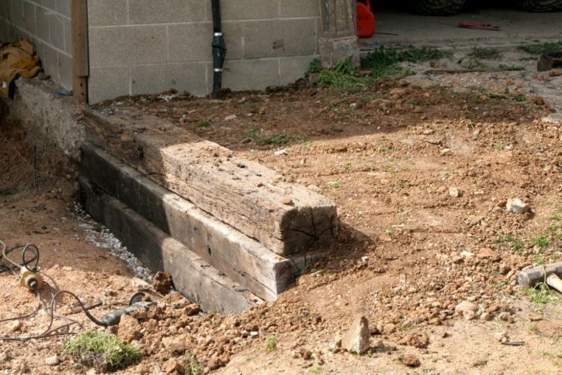 Transform Your Yard With A Railroad Tie Retaining Wall