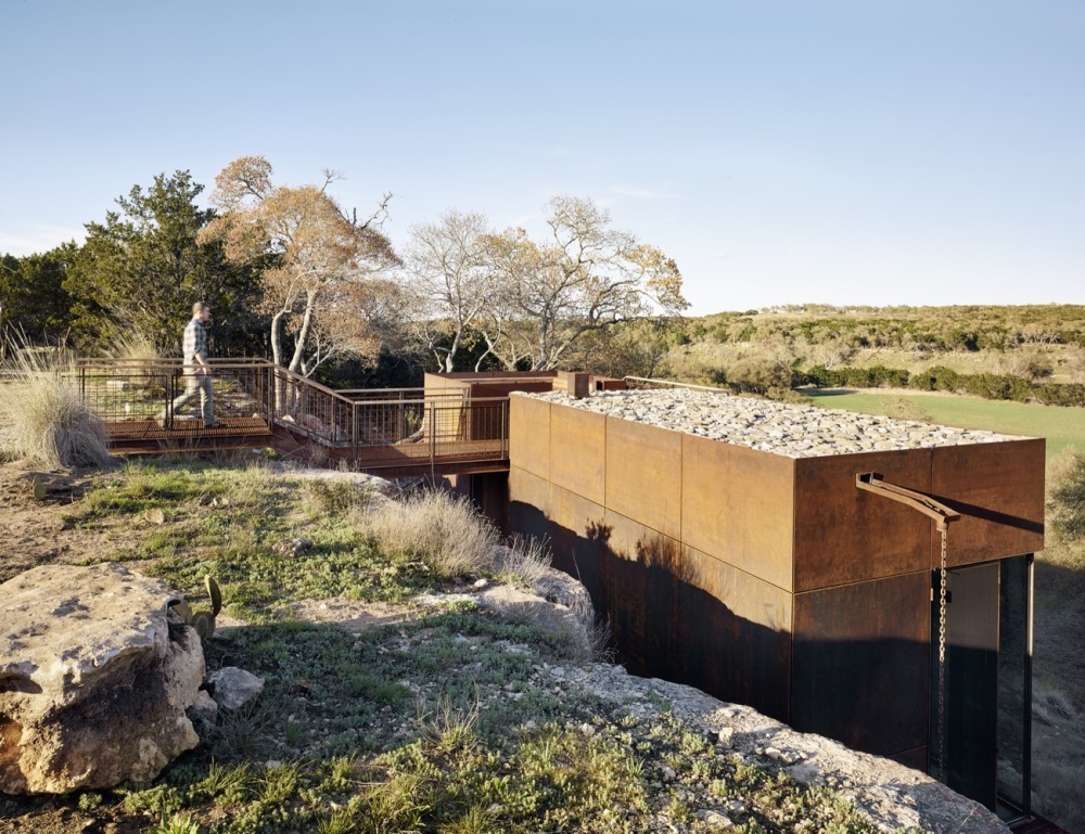 The cabin has its back against the cliff's side which gives it sheltered feel