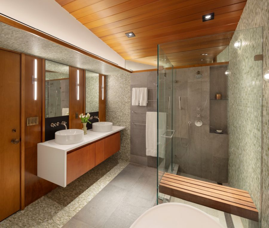 The bedrooms have en-suite baths with glass walk-in showers and other stylish features