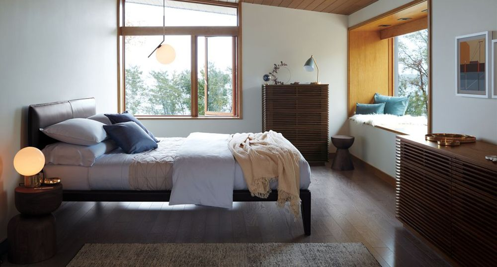 This bedroom has a cozy window seat overlooking the water