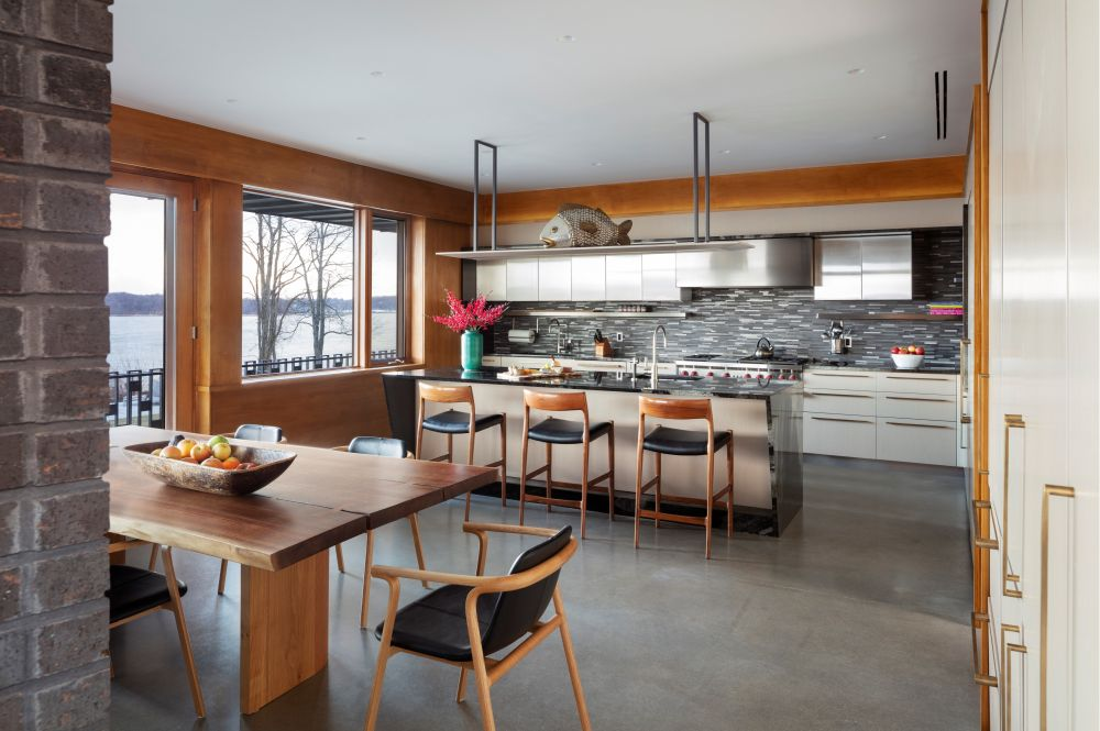The gray concrete floor brings out the beautiful color in the wooden furniture