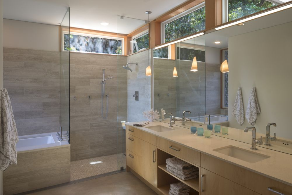 The clerestory windows bring natural light into the bathroom without exposing the interior