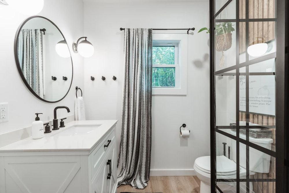 The bathroom is big enough for a stylish vanity, a toilet area and a walk-in shower
