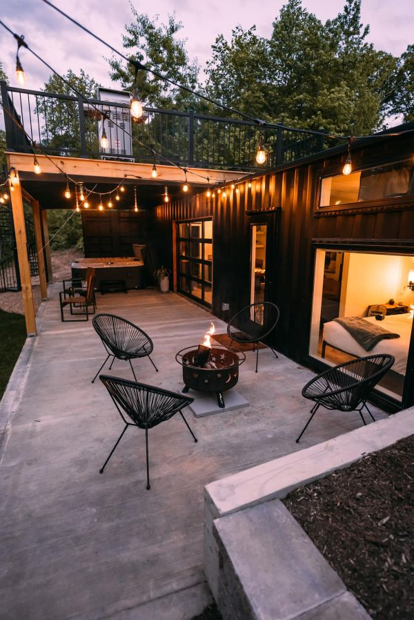 Outside on the deck there's a hot tub area and also a fire pit seating area