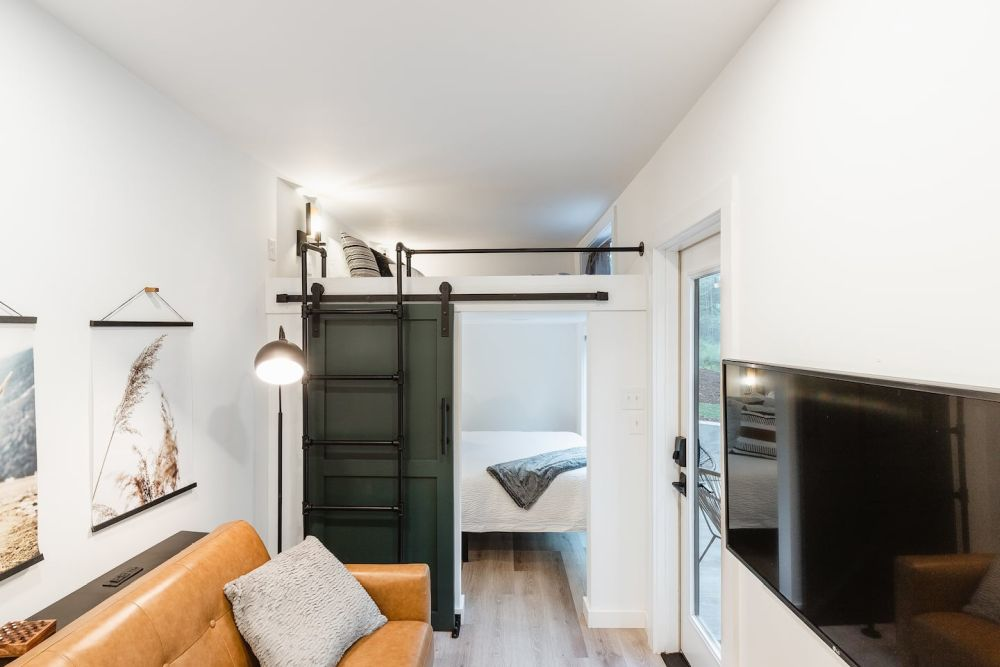 The two bedrooms are stacked to save space and make the most of this small container house