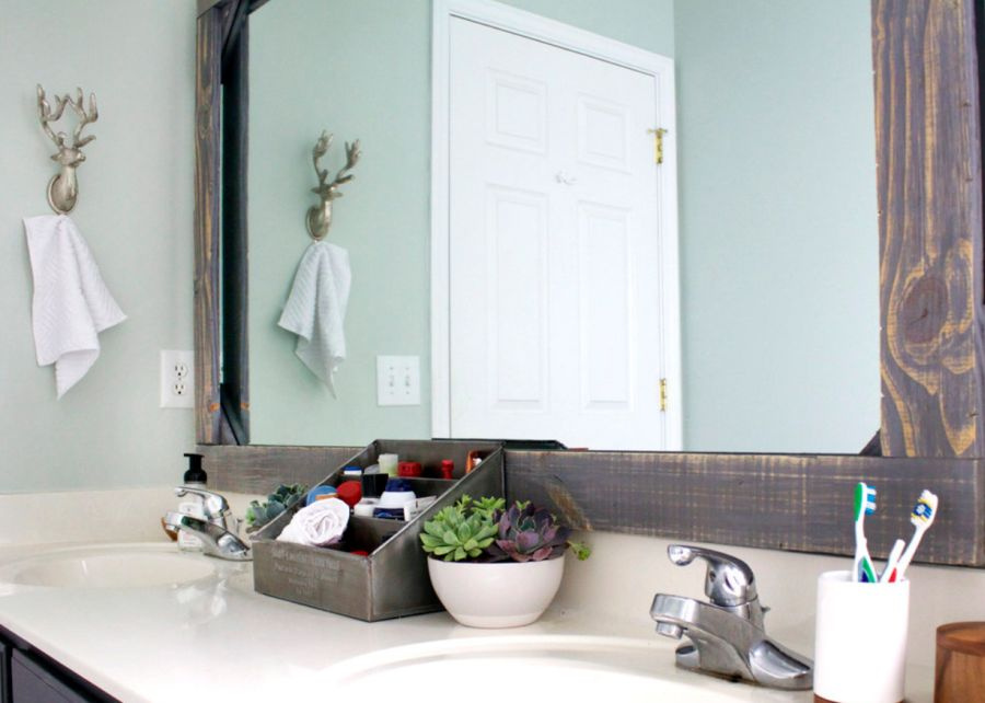 Rustic wood-framed mirror for the bathroom