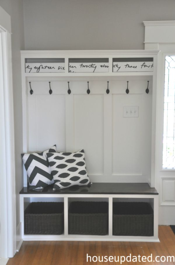 An entryway stand with cubbies